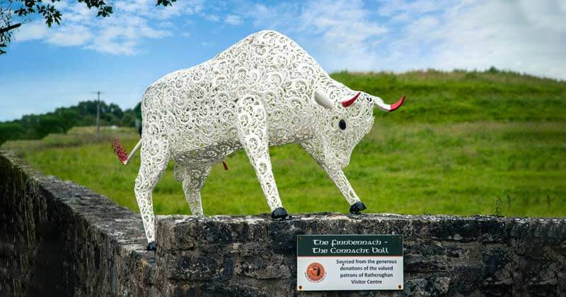 A metal bull figurine in front of rathcroghan Visitors centre